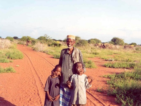 Internally displaced pastoralist with his children at a village in Wajir District, Kenya - Panos London
