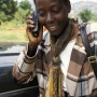 A woman on her mobile phone in Uganda / Betty Press - Panos Pictures
