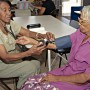 Jamaica | A nurse, Ivy Holder, checks Dorrie Huie's blood pressure. Carribean countries have a large number of nurses move to work in other countries, but a new report suggests this might bring positive outcomes / Neil Cooper - Panos pictures