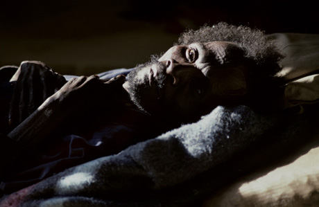 Malawi | A man with HIV lies on a bed waiting to be moved in the Zomba General Hospital. There is little research about men who have sex with men in Malawi, which one of the reports highlighted here attributes to homophobia / Patrick Brown - Panos Pics