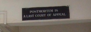"A sign in a morgue in Imphal, Manipur, reads ""Postmortem is a last court of appeal"""