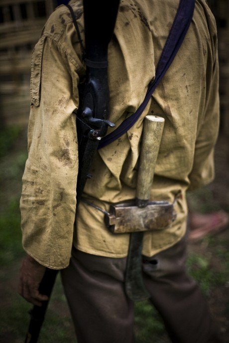 A villager in northeast India carries an old hunting rifle and machete. In Manipur more than five decades of insurgency means life is ruled by the gun, according to Ambra