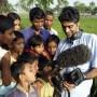 BANGLADESH | Journalist Ashok Prasad shows film footage to the villagers of Dinajpur / G M B Akash - Panos Pictures