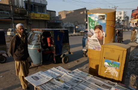 Newspapers are displayed at a road-side news stand in Peshawar