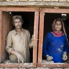 A couple stands in a new house built with help from Czech NGO People in Need. Zubaida Noor's NGO is also building homes for flood victims.