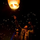 Panos is vaguely translatable as torch or beacon. Children send a fire lantern into the sky at the beginning of the water festival in Yunnan | Panos Pictures