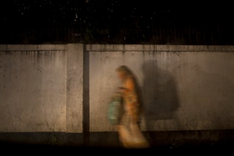 A woman walks home caught in in a monsoon storm in Dhaka.