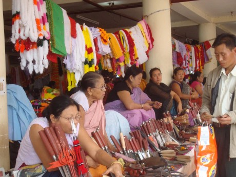"""Women sell knives at the """"Women's Market"""" in Imphal. Manipuri women have traditionally borne the brunt of economic responsibilities in the household - Takhelchangbam Ambravati 