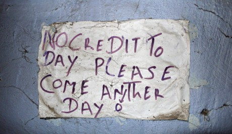A note on the wall of a local restaurant in Mali. Women have a hard time getting credit, so housewives have formed an association to provide loans for women - Sven Torfinn | Panos