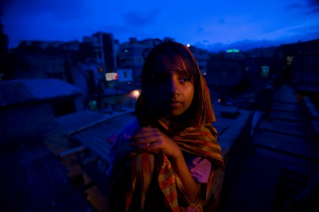 10 year old Jumni stands at the Geneva Camp in Dhaka, home to the Urdu-speaking community who were stranded during the separation of Bangladesh. Panos South Asia is a institute that works to make sure voices like these are heard - Shiho Fukada | Panos Pictures