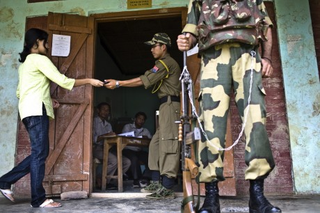 Villagers cast their vote amidst high security in the polling station in Moirang. About 62 percent of the 802,000 registered voters voted in an incident-free second phase of Lok Sabha (Lower House of Parliament) elections for the Inner Manipur parliamentary constituency on April 22nd 2009 - Sanjit Das | Panos Pictures