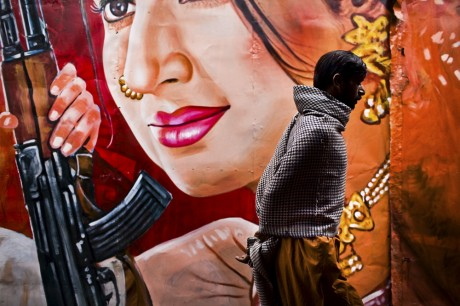 A man walks by a cinema signboard being painted for a Pakistani film in Lahore - Zackary Canepari | Panos Pictures
