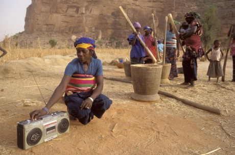 Dogon women listening to the radio as they work, Mali - Rhodri Jones | Panos Pictures