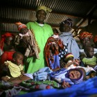Kadia Keita, a local midwife, is pictured with some of the babies that she has helped to deliver at the health centre in Bomau village - Abbie Trayler-Smith | Panos Pictures