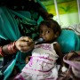 Anita feeds her 18 month old malnourished daughter Rajni at the nutritional rehabilitation centre in the pediatric ward at Maharani Laxmibai Medical College in Jhansi - Sanjit Das | Panos Pictures