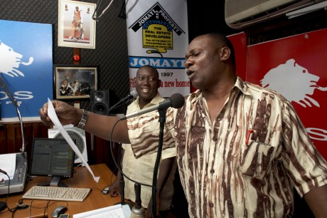 DJ's Cato Lubwama (left) and Abbey Mukiidi announce the names on new born babies on the Kalisoliso early morning radio show, in Kampala, Uganda. Kalisoliso, meaning 'poke you nose', is one of the most popular radio shows in Uganda, with some 6 to 7 million listeners, and actively promotes high fertility rates, mainly among the Buganda tribe - Andrew McConnell | Panos Pictures