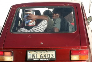 Haitians going to seek work hitchhiking on an old Brasilian car - Lilo Clareto | Panos London