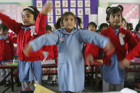 School girls dance and sing during music lessons at St. Theresa's School - Warrick Page | Panos Pictures