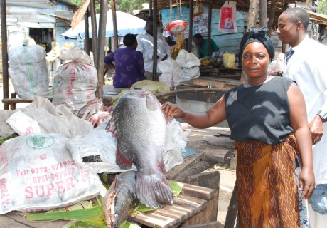 Rebecca Namayanja at a local fish market - Kabangala Mohammed | Panos London