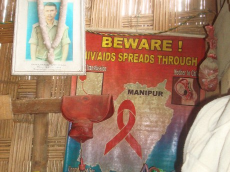 An AIDS awareness poster hangs in a corner of Nungshi's hut - Anjulika Thingnam | Panos London