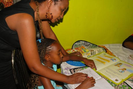 Margret Mukoma helps her daughter Michelle with homework - Adrian Gathu | Panos London