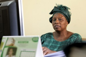 Bintou Coulibaly, a women's rights advocate, at her desk in Bamako - Andrew Esiebo | Panos London