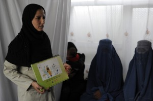 An Afghan health worker talks about family planning to a group of women in a clinic in Kabul - Farzana Wahidy | Panos London