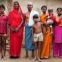 "Kelaji and Tribhuvan Adivasi pose for a family portrait with four of their six children and one grandchild. Tribhavan, a farm labourer, says that ""it was a mistake to have so many children. Food is difficult for us."" - Suzanne Lee 
