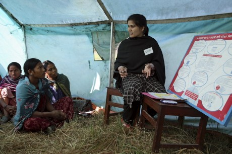 Women gather in a tent in rural Nepal to hear the details of a health project - Peter Barker | Panos Pictures