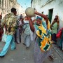 A woman takes part in a game of volleyball on the streets of Mogadishu, Somalia, despite the presence of armed militia - Martin Adler | Panos Pictures