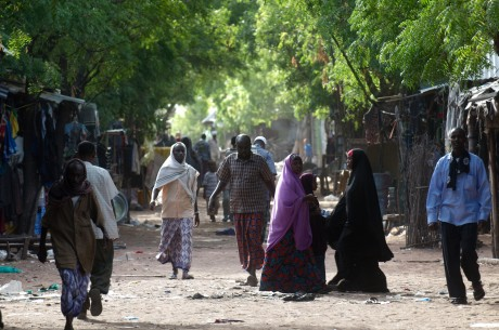 Refugees walk along the main street in Hagadera camp in Dadaab - Piers Benatar | Panos Pictures