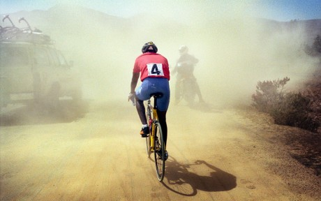 The Tour of Eritrea cycle race. Dust covers the road to Dekmhare - Chris de Bode | Panos Pictures