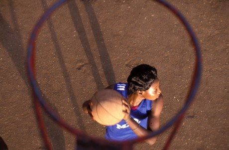 A member of the Malian women's basketball team seen through the hoop - Rhodri Jones | Panos Pictures