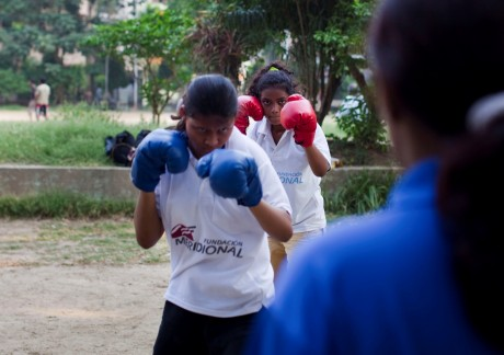 Girls line up in front of boxing coach Razia Shabnam for a training session in the park - Suzanne Lee | Panos London