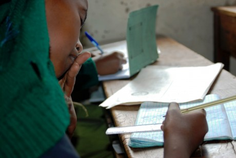 A student at a public primary school in Kenya takes notes during a lesson - Adrian Gathu | Panos London