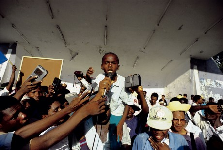 This photograph taken by Panos Pictures photographer, Marc French, in 1991 of a young orphan challenging the media at an election rally in Haiti became a signature image for Panos.