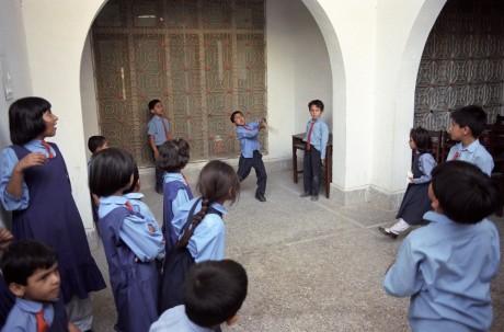 Children play cricket at the Sheffield Grammar School in Pakistan - Tim Smith | Panos Pictures